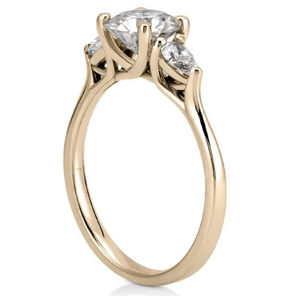 pear side stone engagement ring with trellis setting in yellow gold