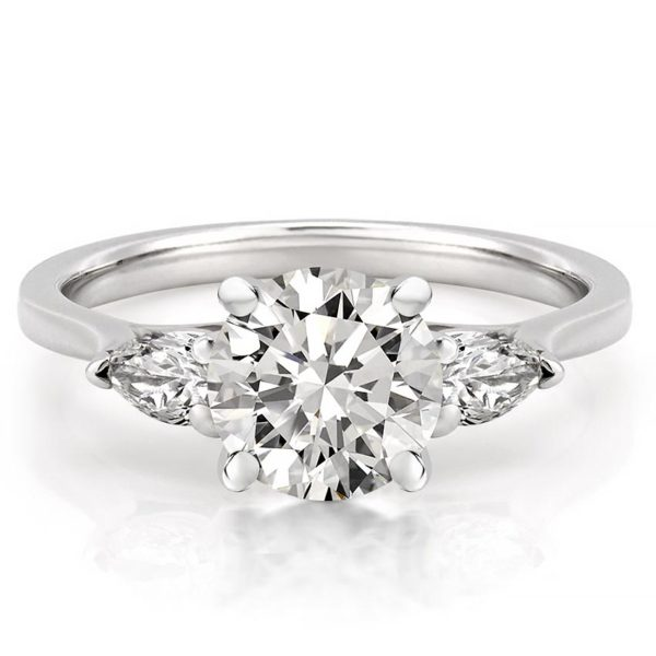 engagement ring with round center stone and pear side stones in white gold