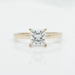 solitaire engagement ring with princess moissanite in rose gold