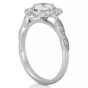 white gold halo engagement ring with pave diamonds and round moissanite