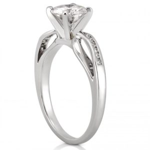 white gold engagement ring with ribbon design