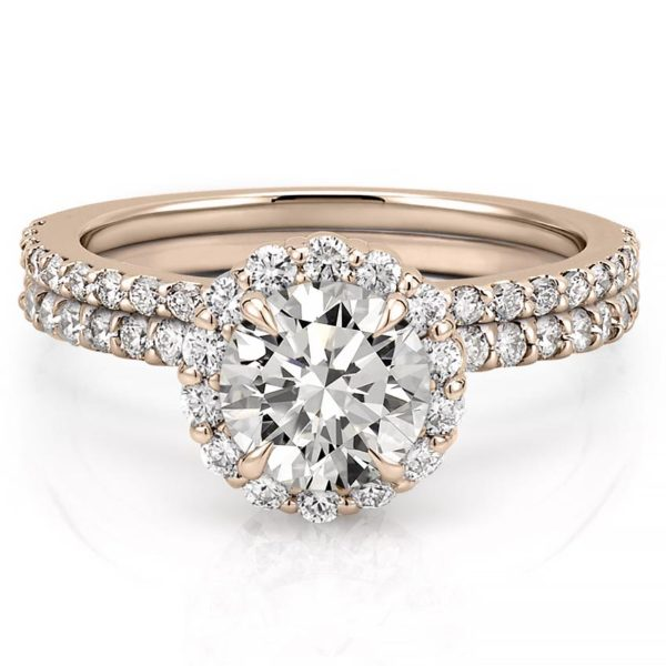 rose gold scalloped halo engagement ring set with round moissanite