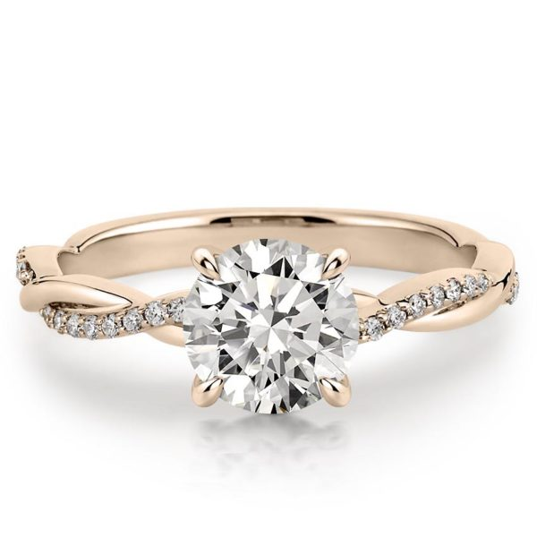 rose gold engagement ring with twisted pave band and 1 carat round moissanite