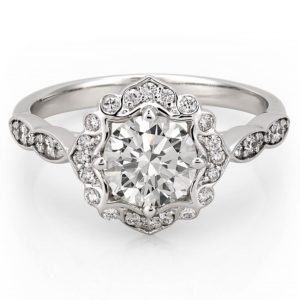 engagement ring with floral halo and round moissanite in white gold