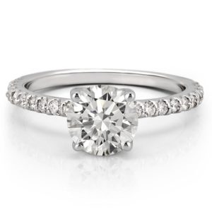 round cut affordable moissanite engagement ring with diamonds on band and basket in white gold