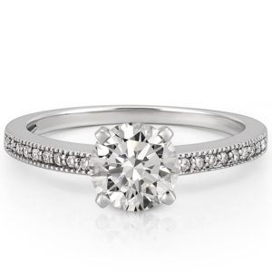 Delicate engagement ring with milgrain detail in white gold