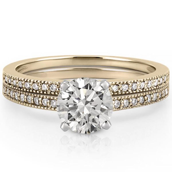 Delicate engagement ring set with milgrain detail in yellow gold
