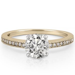 Delicate engagement ring with milgrain detail in yellow gold
