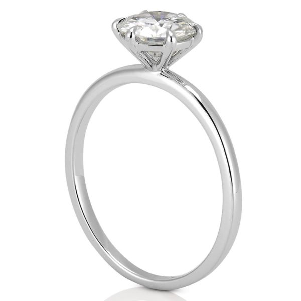 white gold affordable delicate solitaire ring with round moissanite