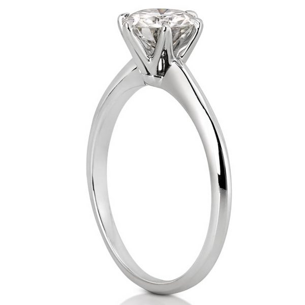 white gold solitaire with six prongs and one carat round moissanite