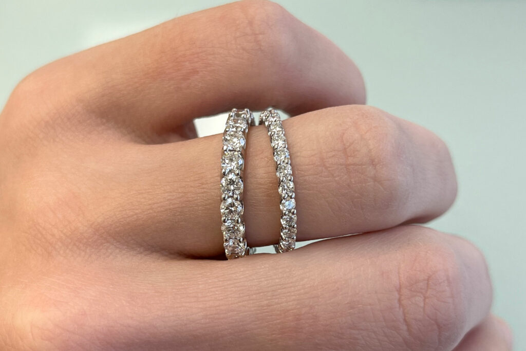 comparison of 2mm and 3mm scalloped lab diamond eternity bands in white gold